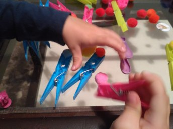 playing with pegs and pompoms.jpg